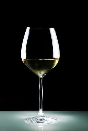 White wine on black background. photo
