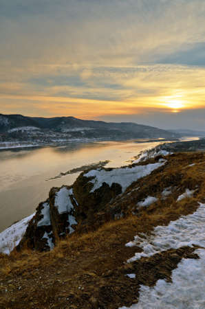 Winter landscape. Mountains and river. photo