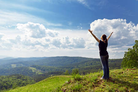 woman arms up: Young woman enjoying the fresh air. Stock Photo