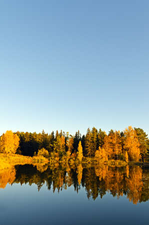 Lake in sunset rays. Fall landscape. Stock Photo - 10999409