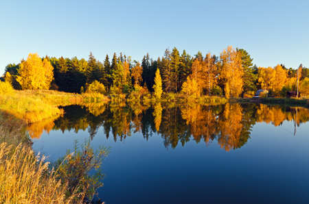 Lake in sunset rays. Fall landscape. Stock Photo - 11148550