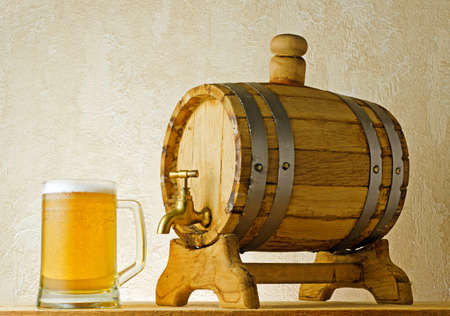 beer barrel: Beer and barrel on the wood table. Stock Photo