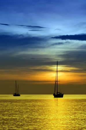 Sailboats at dusk. Tropical landscape. photo