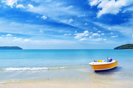 Yellow boat on a beach. Stock Photo - 12322713