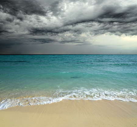 stormy sea: Tropical beach at cloudy weather.