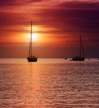 Sailboats at dusk  Tropical landscape  photo