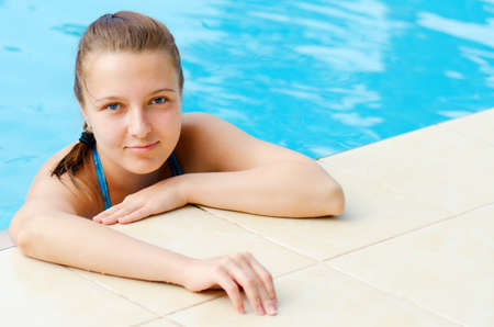 Young woman in a swimming pool  Stock Photo - 12625886
