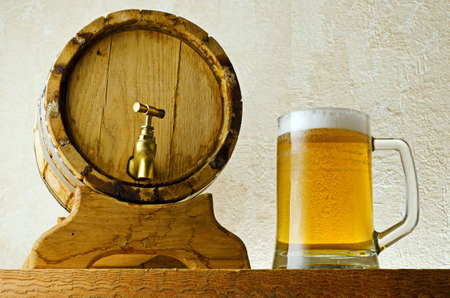 Beer and barrel on the wood table  photo
