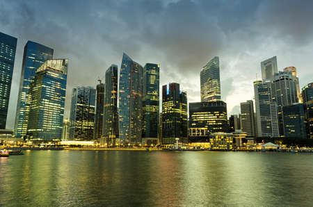 Singapore skyscrapers in downtown at evening time  photo