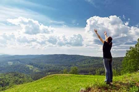 outstretched arms: Young woman enjoying the fresh air. Stock Photo