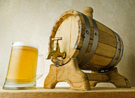 beer tap: Beer and barrel on the wood table. Stock Photo