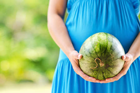 Young woman with watermelon in hands. Stock Photo - 14023014