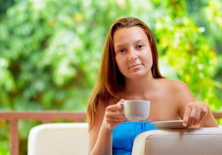 Young woman with cup of coffee. photo