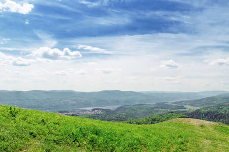 Summer landscape. Green hill and blue sky. Stock Photo - 14034129