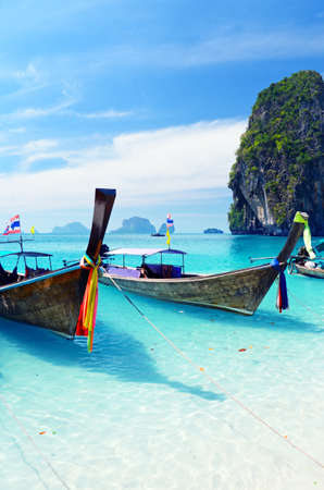 longtail: Clear water and blue sky. Krabi province, Thailand.