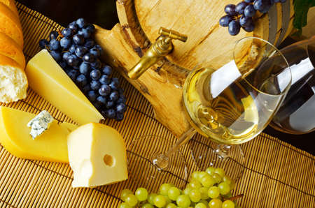 food still: Wine and cheese on the table