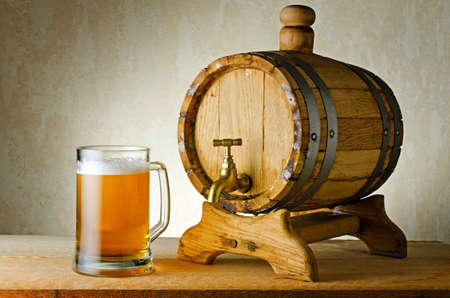 Beer and barrel on the wood table. photo