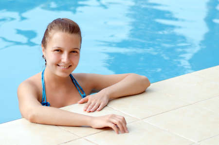 Young woman in a swimming pool. photo