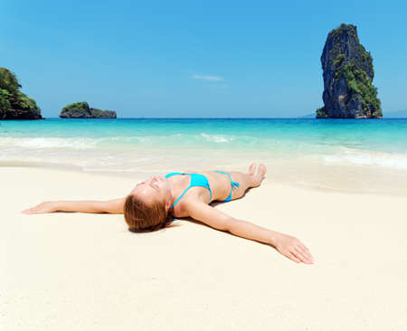 hot legs: Young woman on the tropical beach. Stock Photo