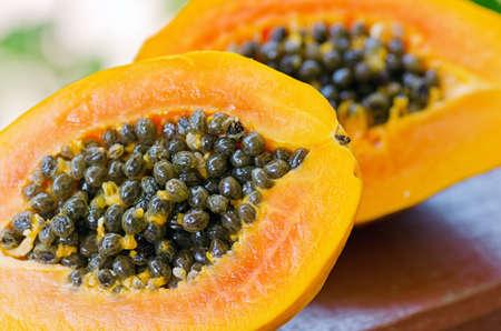 grope: Yellow papaya in the garden. Shallow DOF.