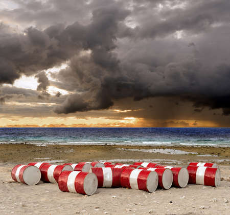 sea pollution: Lot of oil barrels on a seashore  Environment pollution