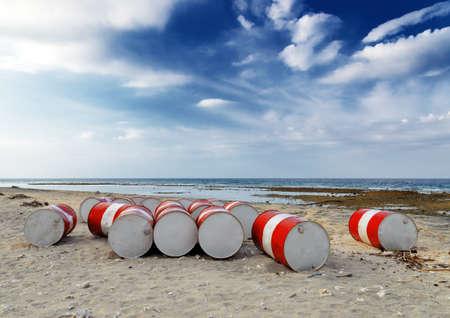 Lot of oil barrels on a seashore  Environment pollution  photo