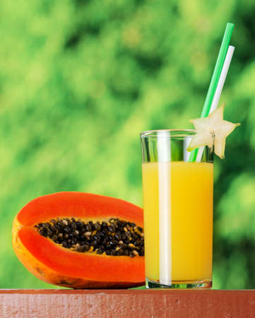 Glass of papaya juice in a garden. photo