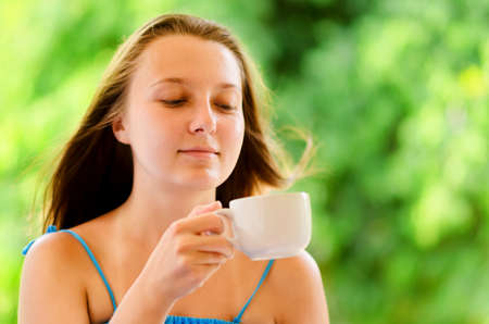 Woman enjoys cup of coffee  photo