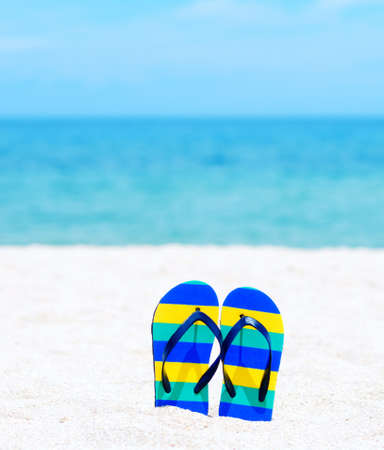 Flip flops on a tropical beach. photo