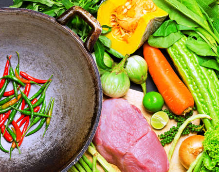 stir: Preparation to asian traditional cooking. Wok and vegetables.