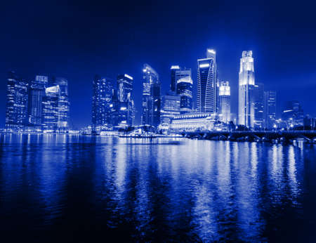 commercial district: Singapore city skyline at night.