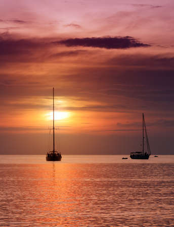 Sailboats at dusk. Tropical landscape. photo