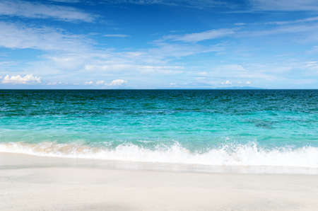 White sand beach and blue sky. Stock Photo