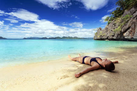 hot legs: Young woman on a tropical beach. Stock Photo