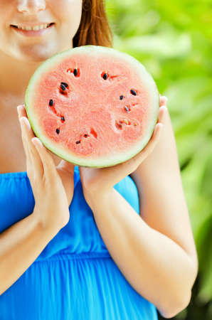 Young woman with watermelon in hands. Stock Photo - 15424751
