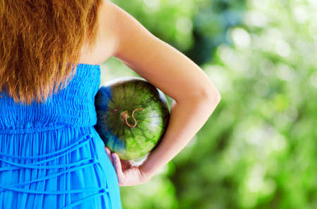 Young woman with watermelon in hands. Stock Photo - 15478735