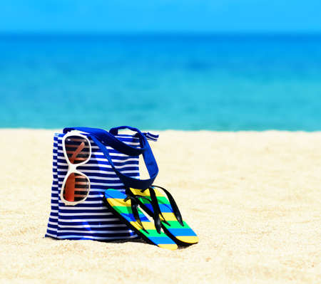 sunbathing: Beach accessories. Concept of summer vacations. Stock Photo