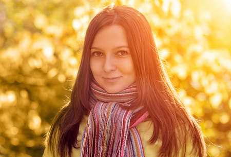 Young woman in the autumn park. photo