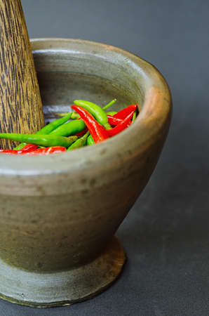 pepper grinder: Red and green pepper in mortar.