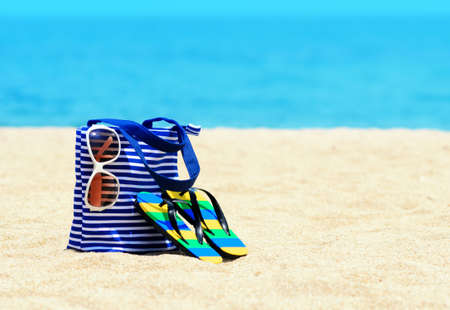 sandals: Beach accessories. Concept of summer vacations. Stock Photo