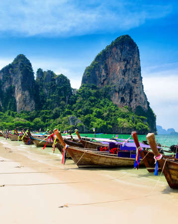 Traditional thai boats at the beach of Krabi province  photo
