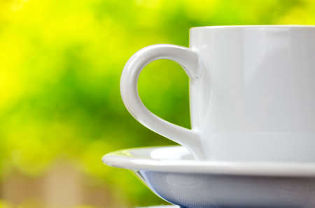 morning tea: Cup of tea on nature background.