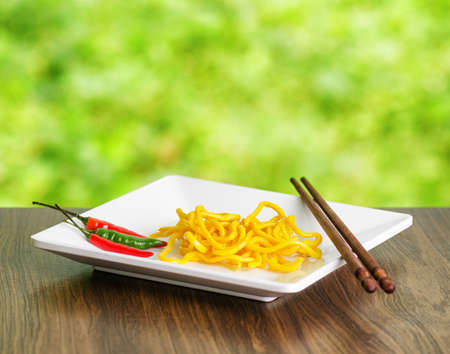 Egg noodles on nature background  photo