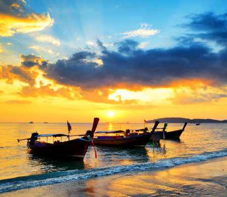Traditional thai boats at sunset beach  Ao Nang, Krabi province  photo