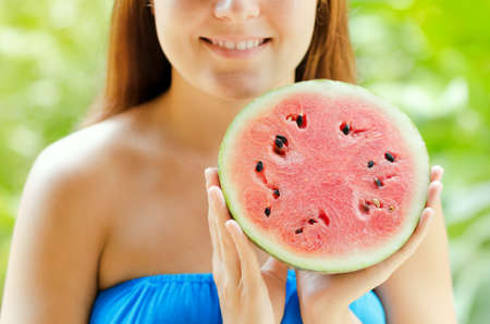 Young woman with watermelon in hands. photo