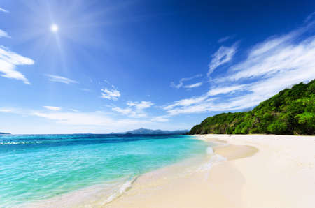 palawan: White sand beach and blue sky. Coron, Busuanga island, Palawan province, Philippines.