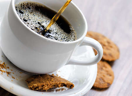 sweet  food: Coffee and oatmeal cookies on wooden table. Stock Photo
