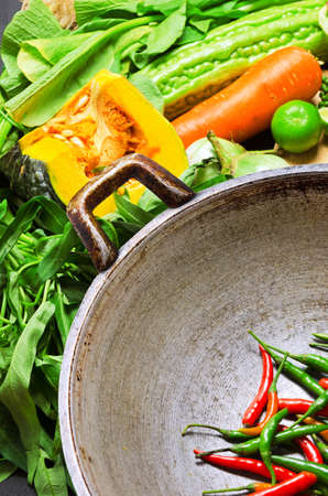 cooking utensil: Preparation to asian traditional cooking. Wok and vegetables.