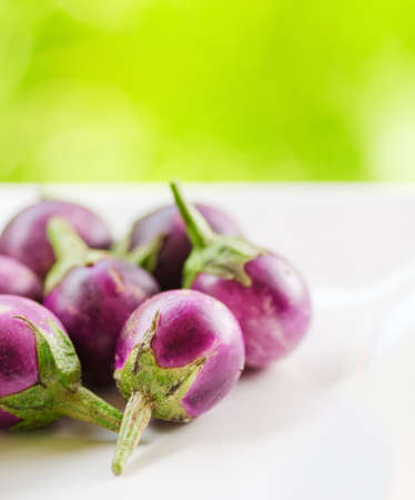 asian produce: Purple eggplants on nature background.