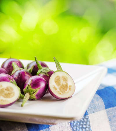 Purple eggplants on nature background. photo